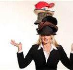 woman wearing multiple hats